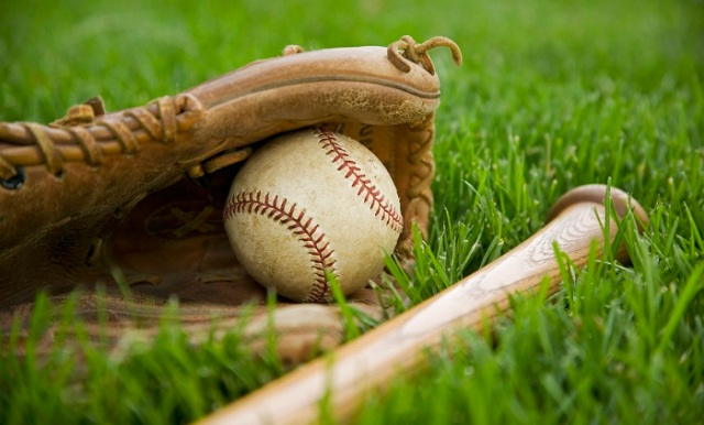 Baseball Equipment Laying on Grass 700 x 423
